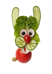 Funny hare made of vegetables on isolated background