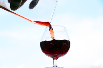 image of the current in a glass of red wine