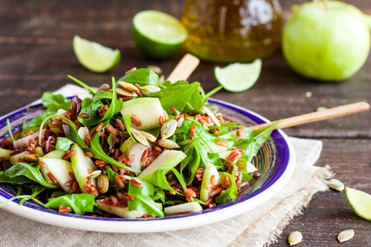 salad with red rice, apple and arugula