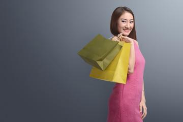 Shopping asian woman holding shopping bags