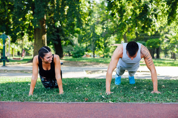 Man and woman doing push up