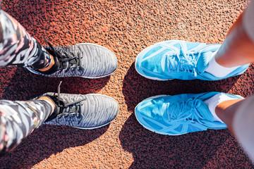 Couple in sportswear ready to run