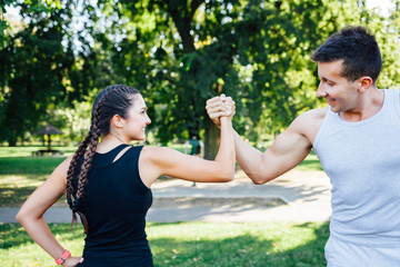 Sport couple celebrating cheerful and happy giving high five