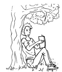 Jongen leest een boek onder een boom