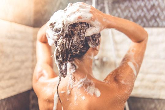 Beautiful woman taking shower