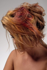 Portrait of a beautiful girl with dyed messy hair, professional hair colouring