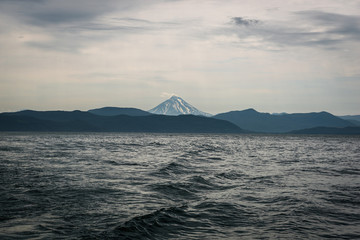 Waves leading the eye to Vilyuchinskaya Vulcano across Avacha Bay, Kamchatka, Russia