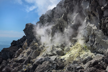 Smelly fumarole in the lava in Avachinsky Volcano's crater, Kamchatka, Russia