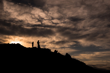 Silhouettes during sunset on the slopes of Tolbachik Volcano, Kamchatka, Russia