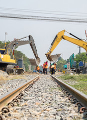 Backhoe and worker improvement construction of railway