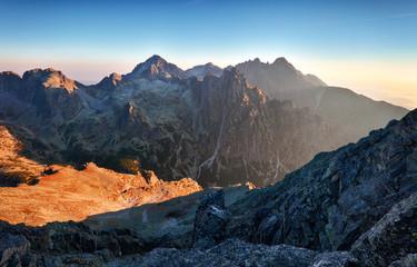 Fototapete - Mountain sunlight at sunrise, Tatras