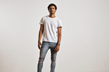 Full-body shot of an athletic attractive young male in ripped light blue jeans and blank white shortsleeve t-shirt