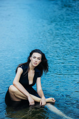 young sexy woman sitting in water