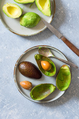 Halved avocados, its shells and seeds