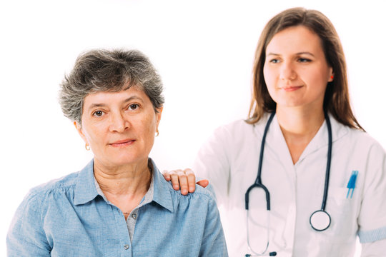 Worried patient being comforted by her doctor