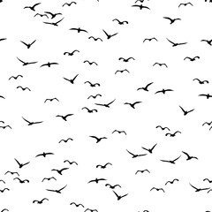 Seamless pattern of a flock of flying birds
