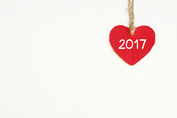 Red fabric heart with 2017 word white wall background