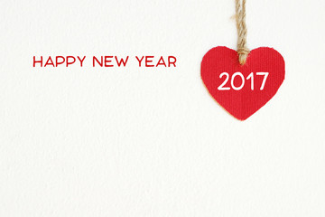 Red fabric heart with 2017 word and happy new year words