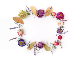 Framework with dry flowers on white background. Flat lay. Top view