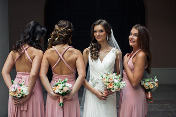 Bridesmaids with the bouquets and a bride