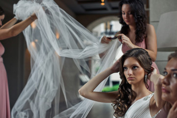 Bridal veil in the hands of the bridesmaids