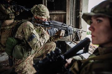 Soldiers on patrol in destroyed city. Military and rescue operation