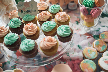 Cupcakes with the green and orange cream