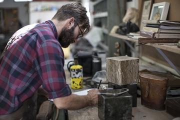 Man in workshop drawing