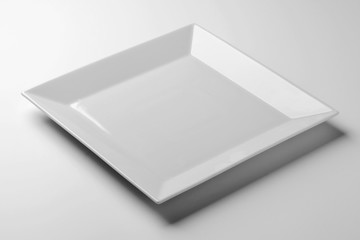 Single Square white plate on white table