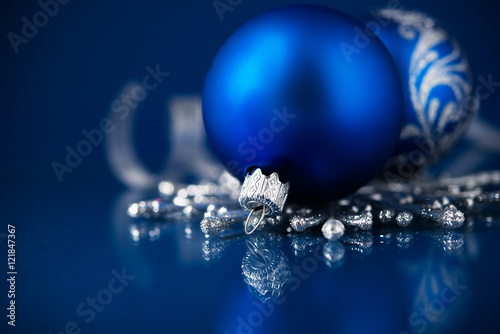 silver and blue christmas ornaments on dark blue background merry christmas card winter holidays