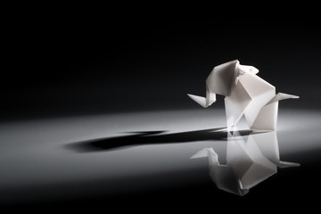 Cute origami art, colored shapes object isolated over a black background