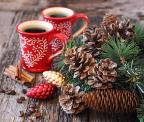 Two cup of coffee, pine cones and New-Year tree decorations