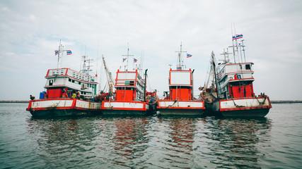 Trawlers Moored On Sea Against Sky