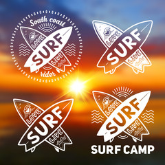 White vector crossing surfing boards logo templates with hand drawn sign Love, Live, SURF on blurred sunset beach background
