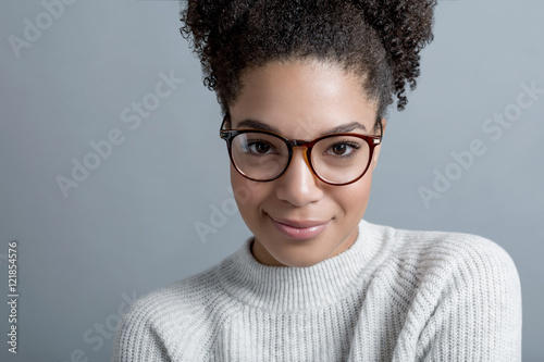 f39dd96abfda Young modern woman with glasses wearing a warm sweater