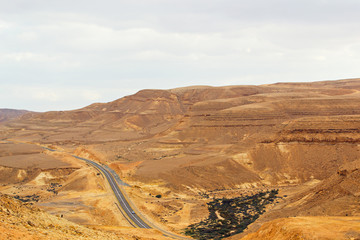 Road in a desert with grey clouds. On the way to Red Sea (Eilat) Israel