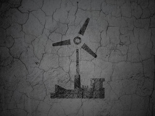 Manufacuring concept: Windmill on grunge wall background
