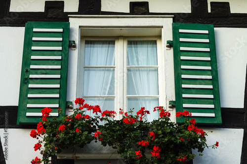 altes fenster im fachwerkhaus mit roten geranien stock photo and royalty free images on. Black Bedroom Furniture Sets. Home Design Ideas
