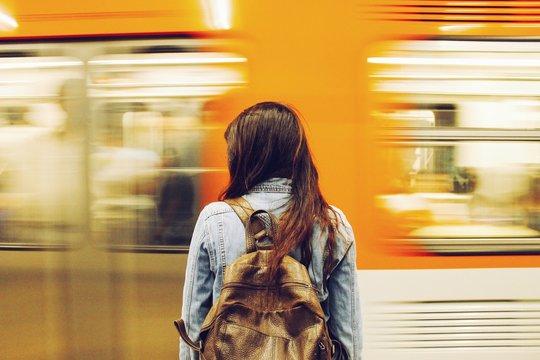 Woman Against Speeding Blurred Train