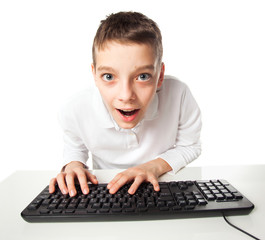 Child looking at  computer