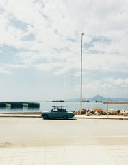 Side View Of A Car On Road Against The Sea