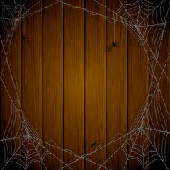 Halloween wooden background with spiders