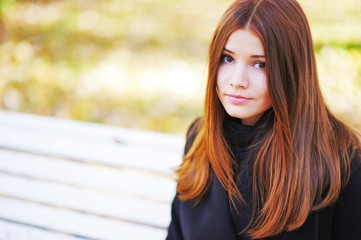 Portrait of a cute brown-eyed girl with her bright  hair on  sun