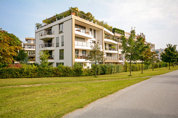 Modern green residential building, apartments in a new urban development