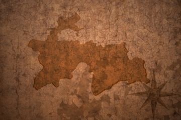 tajikistan map on vintage crack paper background