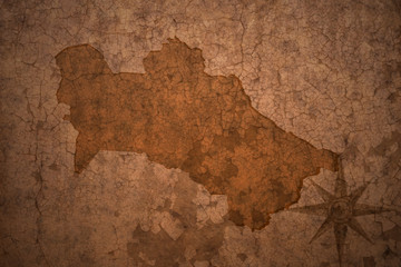 turkmenistan map on vintage crack paper background
