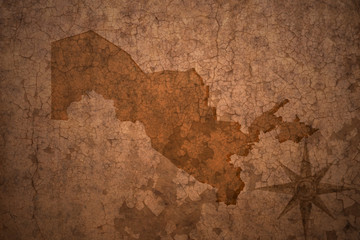 uzbekistan map on vintage crack paper background