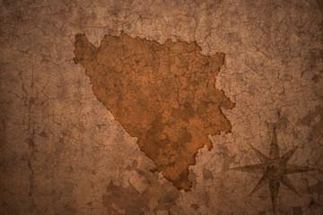 bosnia and herzegovina map on vintage crack paper background