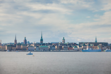 Beautiful super wide-angle panoramic aerial view of Stockholm, Sweden with harbor and skyline with scenery beyond the city, seen from the observation tower, sunny summer day with blue sky