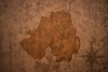 northern ireland map on vintage crack paper background